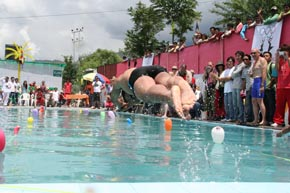 Dorji Tsering diving during the swimming competition